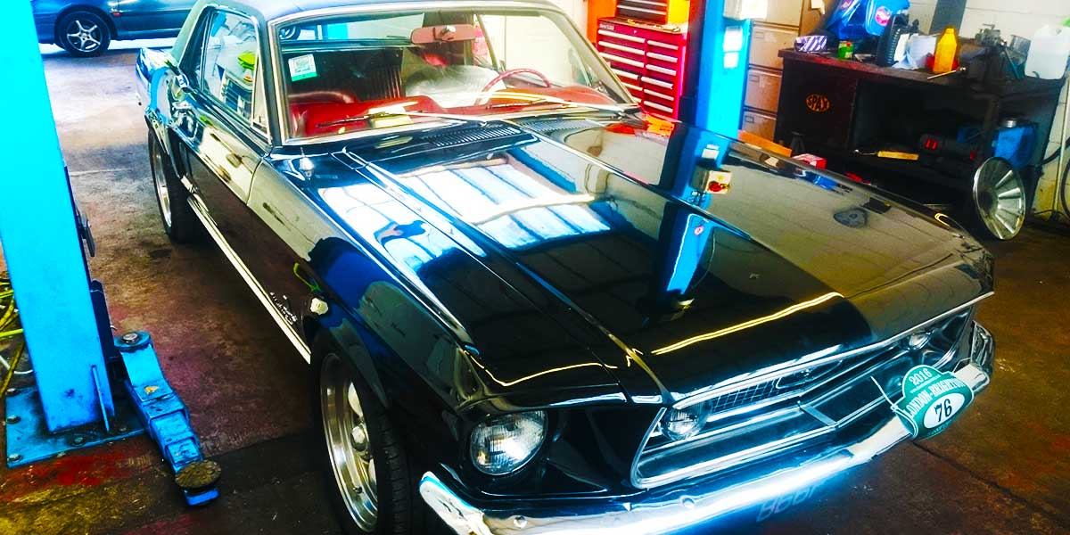 front corner on a ramp a very eye catching nineteen sixties american cadilac in fabulous condition with body to glass painted aqua blue and top to roof painted crisp white