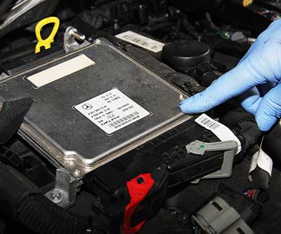 mercedes ecu close up being disconnected for repair