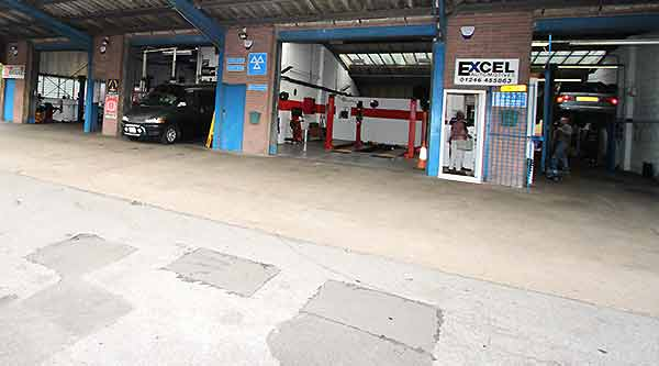 distance view of excel automotives chesterfield garage premises showing four service and repair bays