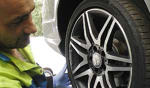 chesterfield tyre fitter checking a vehicles tyre condition