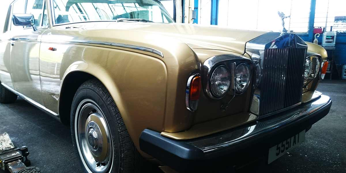 front corner view of a classic rolls royces silver shadow in for repairs to the engine and brakes
