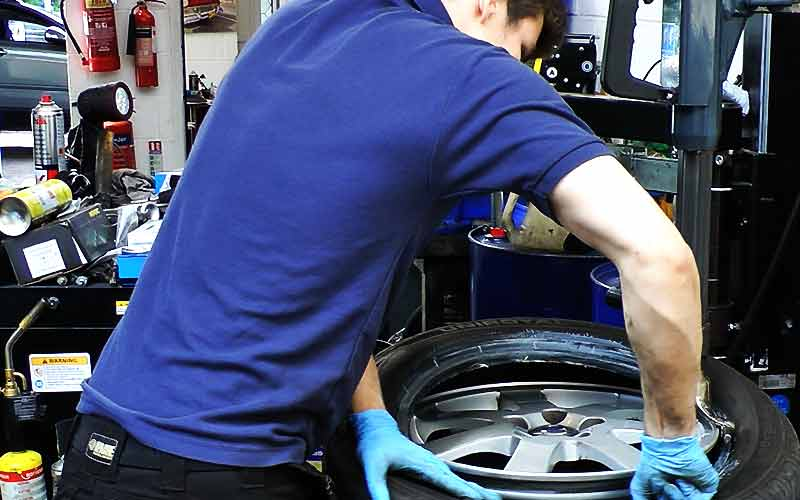 excel tyre fitter fitting a brand new performance volvo tyre