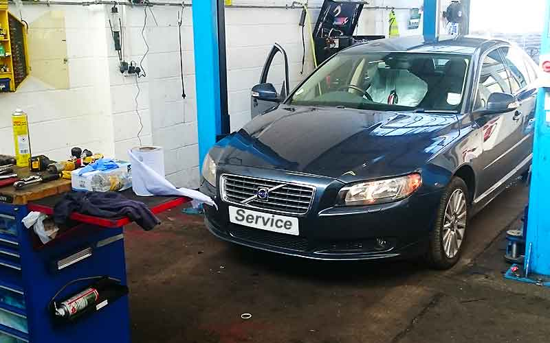 older volvo in excels volvo garage being checked for faults and problems